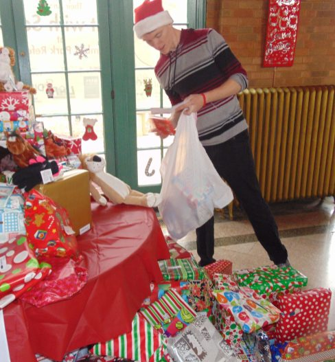 Santa's helpers deserve some gifts of their own for keeping the toy drive on track Saturday.