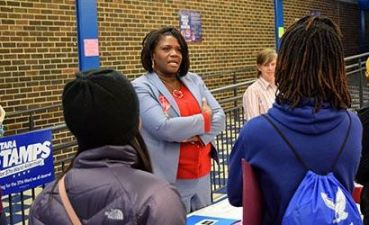 37th Ward candidate Tara Stamps talks with students at the Mikva Challenge kickoff at Jones College Prep High School in the South Loop.