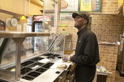 Kevin Cunningham works behind his West Side Subway shop that he opened in December 2013. (David Pierini/staff photographer)
