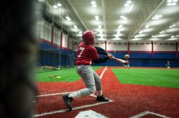 Christian William 12, of the Garfield Park little league team swings during practice at the newly indoor baseball field located at UIC. (William Camargo/Contributor)