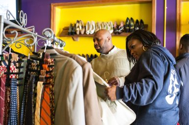 Tara Stamps, above, browses clothes at Second Time the Charm Boutique last Saturday. (Max Herman/Contributor)