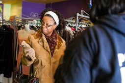 Stacia Crawford, above, tries on a coat at Second Time the Charm Boutique. (Max Herman/Contributor)