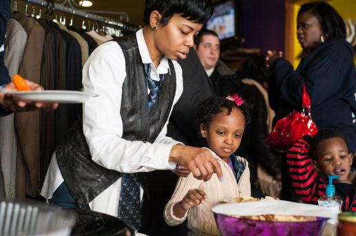 Zoey Starr, left, helps her mother Shiwanda perpare a food table for customers at Second Time the Charm Boutique last Saturday. (Max Herman/Contributor)