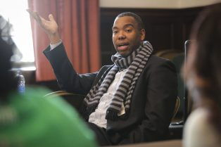 """Author Ta-Nehisi Coates, who wrote """"The Case for Reparations"""", speaks to students at Dominican University on Thursday, February 26, 2015. (Chandler West/Staff Photographer)"""