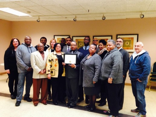 The West Garfield Park Community Stakeholders show off their certificate after returning back to Illinois.