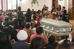 Patricia Chatman, left, speaks of her son, during his funeral service. (Chandler West/Staff Photographer)