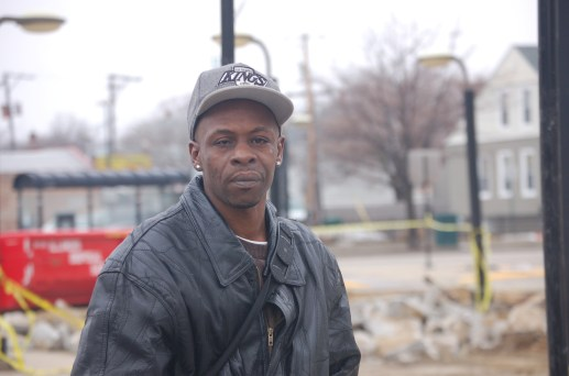 Richard Naylor, a CTA passenger, in front of the bus turnaround at Austin and Chicago. Michael Romain/Staff.