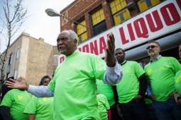 Rep. Danny Davis (D-IL) speaks outside Personal Liquors, 4241 West Madison St, which the advocacy group West Garfield Community Stakeholders says is a positive example of proper business practices, on Saturday. The group gathered to speak out against underage drinking. | CHANDLER WEST/Staff Photographer