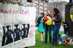 "Ana Mercado and Melissa Hernandez sing ""Ella's Song"" during a vigil for mothers with children facing incarceration held across from Cook County Jail on Saturday. 