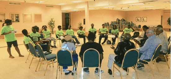 West Garfield Park Youth Council member leads a Community Empowerment Meeting discussion