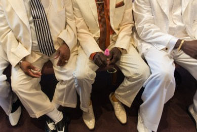 Fathers dressed in white sit at Corinthian Temple Church of God in Christ in the west side of Chicago on Father's Day June 21, 2015. | WILLIAM CAMARGO/Staff Photographer