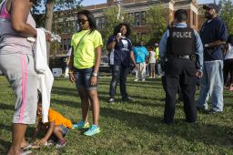 Police and civilians gathered at Moore Park in the Austin neighborhood where National Night Out took place on Tuesday, August 4, 2015. National Night Out is a crime prevention event where police get to know community members in the 15th district. | Alex Wroblewski/Contributor