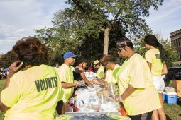 Volunteers prepare dinner at Moore Park in the Austin neighborhood where National Night Out took place on Tuesday, August 4, 2015. National Night Out is a crime prevention event where police get to know community members in the 15th district. | Alex Wroblewski/Contributor