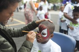 Jaheim Hendrix, gets his face painted as spider-man during the grand opening and ribbon cutting of Everest Charter school in Austin on August 20. | WILLIAM CAMARGO/Staff Photographer