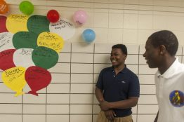 Alontai Hunter, 16, gives a tour of Camelot Academy with his classmate Barry Evans, 17, during the school's grand opening and open house on Oct. 28, 2015, in West Garfield Park. | William Camargo/Staff.