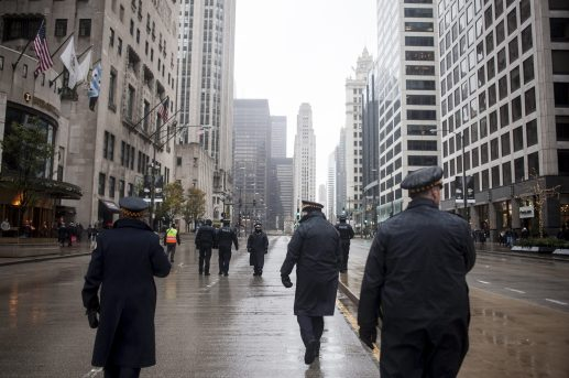 Police officers patrol the streets during the Nov. 27 Laquan McDonald Black Friday demonstration on the Magnificent Mile. The march, which drew at least 2,500 people, was led by Rev. Jesse Jackson and other activists, elected officials and community leaders. | William Camargo/Staff.