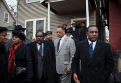 On Dec. 27, religious leaders Rev. Marshall Hatch, left, Jesse Jackson and Rev. Marshall Acree, leave the apartment building where Bettie Jones, 55, was shot to death by Chicago police on Dec. 26. | William Camargo/Staff.