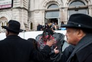 Melvin Jones, the brother of Bettie Jones, weeps on the hearse bearing her casket after the Jan. 6 funeral of the 55-year-old mother of five and grandmother of nine. Reverends Ira Acree, left, and Jesse Jackson, right, look on. | William Camargo/Staff