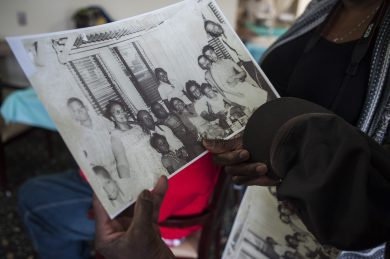 Le'Etter Bryant, 103, looks at a photograph of her much younger self with family members at her birthday party on Jan. 15 in East Garfield Park.| William Camargo/Staff.