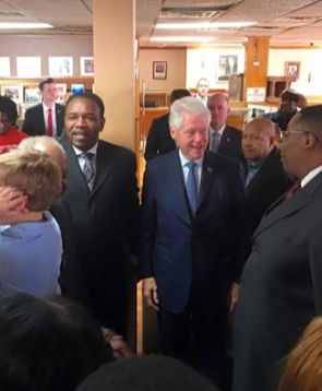 Former U.S. President Bill Clinton, along with Hillary Clinton delegate Rev. Ira Acree, left, and Chicago Alderman Jason Ervin (28th), far right, during a March 8 stop at MacArthur's Restaurant in Austin. | Facebook/Ira Acree