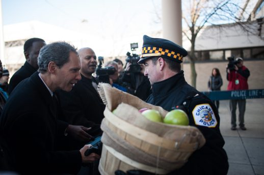Rev. Alan Taylor of Oak Park shakes the hand of a 25th District Chicago Police officer during a peaceful demonstration on March 20 outside of the district's headquarters. The Palm Sunday protest was staged by religious leaders from the West Side and Oak Park.