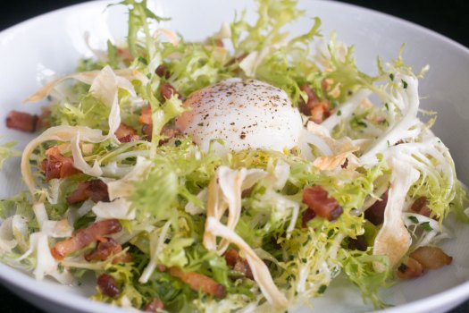 salad lyonnaise, a dish that is among MK's chef's cafe menu | MK Chicago