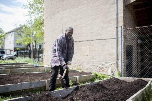 Asar Hapi, a holistic doctor and gardening enthusiast, volunteers in Mercy Housing's urban garden in Austin on May 7. Fresh produce is a pivotal aspect of Hapi's practice. | William Camargo/Staff.