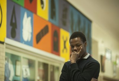 DeShawn Adams, the Austin VOISE student who recently won a Gates Millennium Scholarship, relishes in the accomplishment at his high school on May 12. | William Camargo/Staff