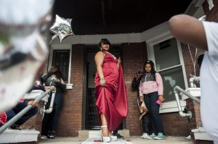 Quinteria Harris, 18, strikes a glamour pose outside of her Laramie Ave. home on May 20, prom night. | William Camargo/Staff
