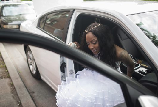 Hatley, 18, graciously gets out of her car as she was leaving for prom in order to pose for photographs. | William Camargo/Staff