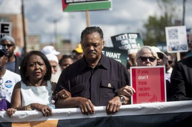 """Rev. Jesse Jackson leads a march from Marquette Park on Aug. 6 to commemorate the Aug. 5, 1966 march from Marquette Park led by Dr. Martin Luther King, Jr. Fifty years ago, Jackson recalled, """"I got hit in the shoulder with a bottle."""" 