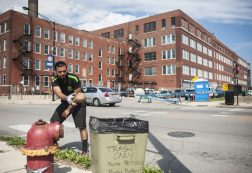A volunteer helps clean up Freedom Square during a weekday last month. | William Camargo/Staff