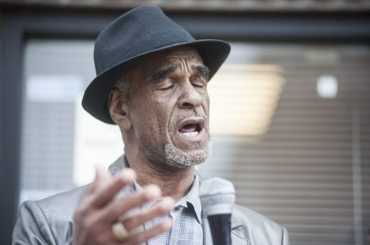 Chicago poet James McGrew recites one of his poems during an Oct. 15 rally in North Lawndale. | William Camargo/Staff