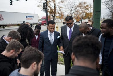 Clergy members, elected officials and activists lock hands outside of Chicago Police headquarters on Oct. 20. They're demanding that Springfield pass a bill that would allow voters to recall the mayor, aldermen and state's attorney. | William Camargo/Staff