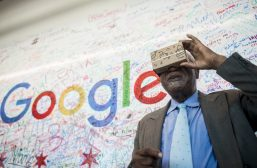 Congressman Danny K. Davis (7th) looks through Google cardboard glasses during a youth technology summit he sponsored at Google's Chicago headquarter's this summer. | William Camargo/Staff