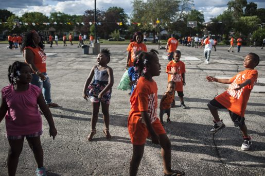Children dance to the music of DJ during BUILD Chicago's 'Hoops in the Hood' event in July. | William Camargo/Staff