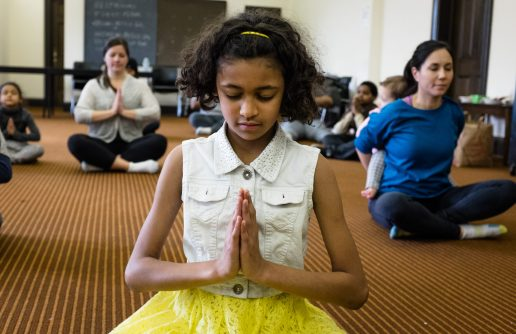 A student preforms a yoga position along with others during yoga and health class, on Saturday, Feb. 4, 2017, at Austin Branch Chicago Public Library.