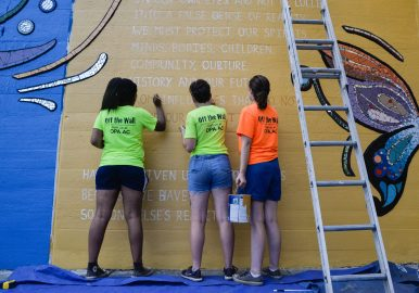 FINISHING TOUCHES: Zaria Gilmore, 21, Jenn Eisner, 18, and Julia Cuneen, 19, all of Oak Park, finish up a new mural last Wednesday, at the corner of Lake Street and Central in Chicago. | Alexa Rogals/Staff Photographer