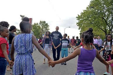 Father Tom Walsh, of St. Martin de Porres Parish, during a prayer walk through Austin in the wake of a shooting in front of Friendship Baptist Church on Sunday, Aug. 13. | Alexa Rogals/Staff