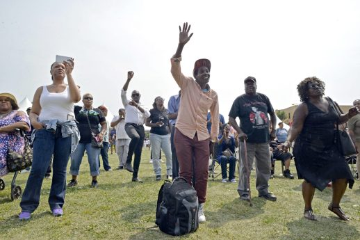 Something to shout about: Attendees sing and dance to live music on Saturday, Aug. 26, 2017, during Ald. Jason Ervin's Summer Festival at Marshall High School Campus Park in Chicago's Austin neighborhood. | ALEXA ROGALS/Staff Photographer