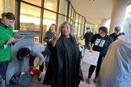 Blanche Clark, of Oak Park, talks with participants on Saturday, Oct. 14, during A Voice For All march at the Oak Park Public Library on Lake Street. | ALEXA ROGALS/Staff Photographer