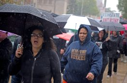 Participants march through the rain on Saturday, Oct. 14, during A Voice For All march as participants march from the Oak Park Public Library to the Farmers Market on Lake Street. | ALEXA ROGALS/Staff Photographer