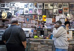 Customers browse the front of the store last Monday, at the Out of the Past Records store on Madison Street in Austin. | ALEXA ROGALS/Staff Photographer