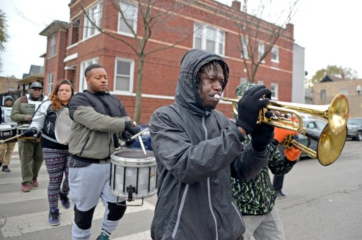Marching out crime: Members of the Exodus marching band walk through the neighborhood performing on Friday, Nov. 17, during a Good Neighbor Campaign rally on Massasoit Avenue near Augusta Street in Chicago's Austin neighborhood. | ALEXA ROGALS/Staff Photographer