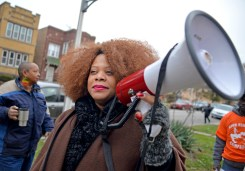 Austin community leader Zerlina Smith asks community members and neighbors to join them on Friday, Nov. 17, during a Good Neighbor Campaign rally on Massasoit Avenue near Augusta Street in Chicago's Austin neighborhood. | ALEXA ROGALS/Staff Photographer