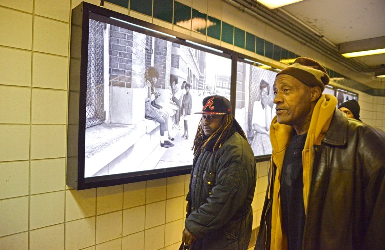 Humanity on Display: Train customers walk past Dorrell Creightney's photographs hung on the wall at the L Green Line Central Station on Central and Lake Street in Austin. | ALEXA ROGALS/Staff Photographer