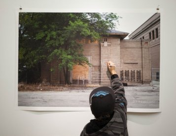 RECLAMATION: Above, an exhibition by photographer Sarah Pooley invites the public to sketch their redevelopment concepts directly onto large scale photo prints. | Photo by Sarah Pooley