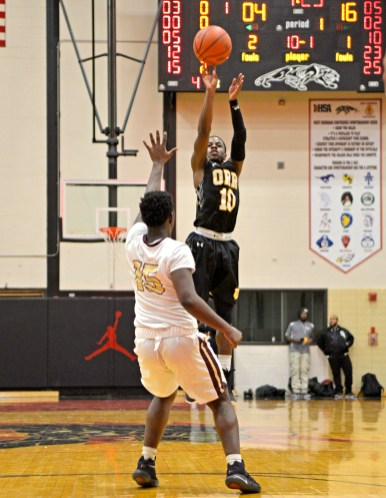 Orr's Mike Taylor (10) shoots a three-point shot on Friday, during a game against Uplift at the 57th annual Proviso West Holiday Tournament at the school's campus in Hillside. | ALEXA ROGALS/Staff Photographer