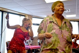 Dorothy Roberson, left, dances and sings music to attendees last Wednesday, during a resident's 105th birthday party at the Heritage Woods of Chicago. | ALEXA ROGALS/Staff Photographer