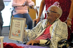 Le'Etter Bryant, of Chicago, sits with her birthday crown and plaque last Wednesday, during her 105th birthday party at the Heritage Woods of Chicago. | ALEXA ROGALS/Staff Photographer